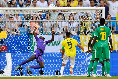 Senegal goalkeeper Khadim Ndiaye, left, fails to stop a goal by Colombia's Yerry Mina, not in picture, during the group H match between Senegal and Colombia, at the 2018 soccer World Cup in the Samara Arena in Samara, Russia