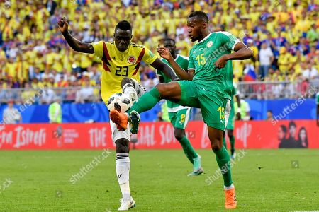 Stock Photo of Colombia's Davinson Sanchez, left, vies for the ball with Senegal's Diafra Sakho, right, during the group H match between Senegal and Colombia, at the 2018 soccer World Cup in the Samara Arena in Samara, Russia