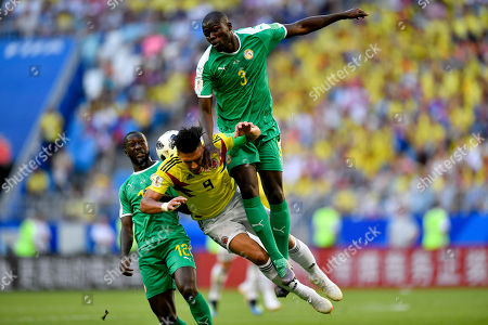 Senegal's Kalidou Koulibaly, right, and Senegal's Youssouf Sabaly, left, foul Colombia's Radamel Falcao, center, during the group H match between Senegal and Colombia, at the 2018 soccer World Cup in the Samara Arena in Samara, Russia