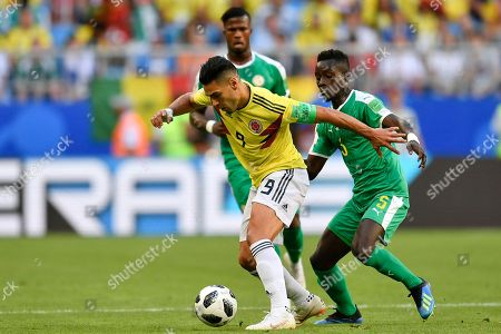 Colombia's Radamel Falcao, left, vies for the ball with Senegal's Youssouf Sabaly, right, during the group H match between Senegal and Colombia, at the 2018 soccer World Cup in the Samara Arena in Samara, Russia