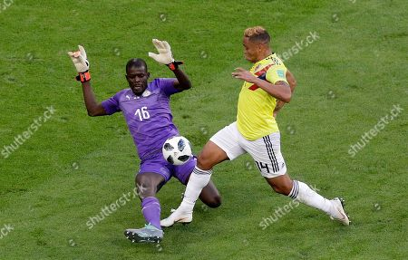 Senegal goalkeeper Khadim Ndiaye, left, saves on Colombia's Luis Muriel during the group H match between Senegal and Colombia, at the 2018 soccer World Cup in the Samara Arena in Samara, Russia
