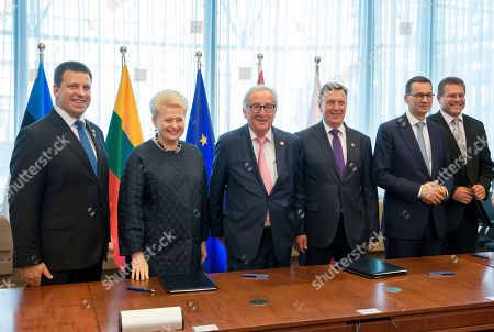 (L-R) Prime Minister of Estonia Juri Ratas, President of Lithuania Dalia Grybauskaite, European Commission President Jean-Claude Juncker, Latvian Prime Minister Maris Kucinskis, and Polish Prime Minister Mateusz Morawiecki during a signing ceremony at the European Council summit in Brussels, Belgium, 28 June 2018. The signature ceremony is for the political roadmap on the synchronisation of the Baltic States' electricity networks with the continental European network (CEN) via Poland.