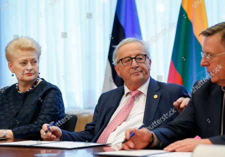 (L-R) President of Lithuania Dalia Grybauskaite, European Commission President Jean-Claude Juncker and Latvian Prime minister Maris Kucinskis during a signing ceremony at the European Council summit in Brussels, Belgium, 28 June 2018. The signature ceremony is for the political roadmap on the synchronisation of the Baltic States' electricity networks with the continental European network (CEN) via Poland.