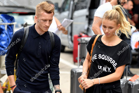 Stock Image of Germany's Marco Reus (L) and his girlfriend Scarlett Gartmann (R) arrive at Frankfurt International airport in Frankfurt, Germany, 28 June 2018. After defeats against Mexico and South Korea and a win against Sweden, the German national soccer team was eliminated from the FIFA World Cup 2018 after the group stage.