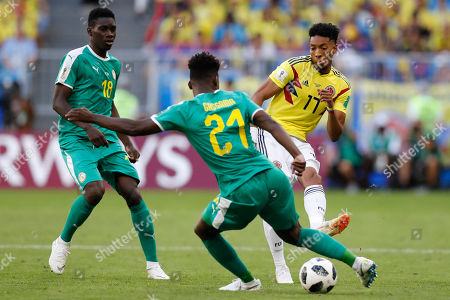 Senegal's Ismaila Sarr, left, Senegal's Lamine Gassama, center, and Colombia's Johan Mojica challenge for the ball during the group H match between Senegal and Colombia, at the 2018 soccer World Cup in the Samara Arena in Samara, Russia