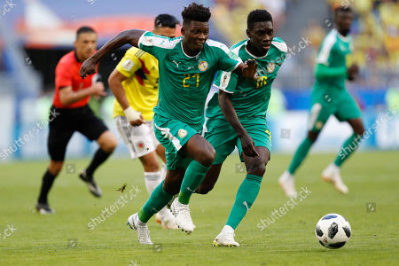Senegal's Lamine Gassama, left, and Senegal's Sadio Mane control the ball during the group H match between Senegal and Colombia, at the 2018 soccer World Cup in the Samara Arena in Samara, Russia