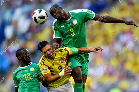 Colombia's Radamel Falcao, center, jumps for the ball with Senegal's Kalidou Koulibaly, right, and Senegal's Youssouf Sabaly, left, during the group H match between Senegal and Colombia, at the 2018 soccer World Cup in the Samara Arena in Samara, Russia