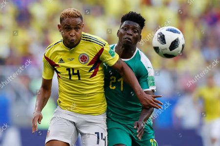 Colombia's Luis Muriel, foreground, and Senegal's Lamine Gassama challenge for the ball during the group H match between Senegal and Colombia, at the 2018 soccer World Cup in the Samara Arena in Samara, Russia