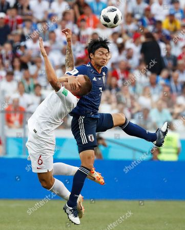 Japan's Gaku Shibasaki, right, hits the face of Poland's Jacek Goralski as they jump to head the ball during the group H match between Japan and Poland at the 2018 soccer World Cup at the Volgograd Arena in Volgograd, Russia