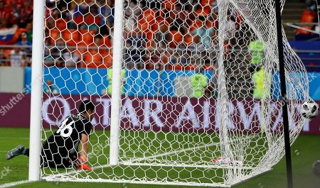 Tunisia goalkeeper Aymen Mathlouthi watches the ball after an own goal by Tunisia's Yassine Meriah during the group G match between Panama and Tunisia at the 2018 soccer World Cup at the Mordovia Arena in Saransk, Russia