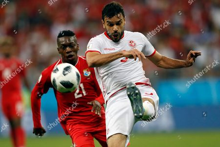 Tunisia's Oussama Haddadi, right, kicks the ball next to Panama's Jose Luis Rodriguez during the group G match between Panama and Tunisia at the 2018 soccer World Cup at the Mordovia Arena in Saransk, Russia