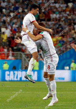 Tunisia's Fakhreddine Ben Youssef, right, celebrates with his teammates after scoring his side's first goal during the group G match between Panama and Tunisia at the 2018 soccer World Cup at the Mordovia Arena in Saransk, Russia