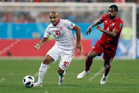 Tunisia's Wahbi Khazri, left, passes the ball as Panama's Gabriel Gomez tries to stop him during the group G match between Panama and Tunisia at the 2018 soccer World Cup at the Mordovia Arena in Saransk, Russia