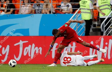 Tunisia's Bassem Srarfi falls down as Panama's Gabriel Gomez goes for the ball during the group G match between Panama and Tunisia at the 2018 soccer World Cup at the Mordovia Arena in Saransk, Russia