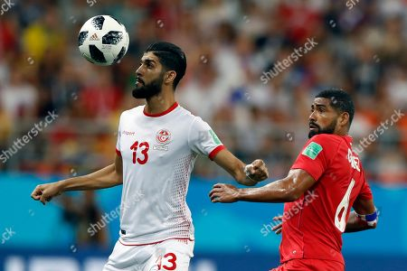 Tunisia's Ferjani Sassi, left, controls the ball as Panama's Gabriel Gomez looks on during the group G match between Panama and Tunisia at the 2018 soccer World Cup at the Mordovia Arena in Saransk, Russia