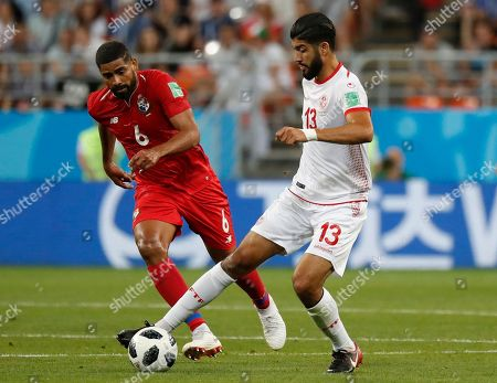 Tunisia's Ferjani Sassi, right, is challenged by Panama's Gabriel Gomez during the group G match between Panama and Tunisia at the 2018 soccer World Cup in the Mordovia Arena in Saransk, Russia
