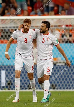 Tunisia's Fakhreddine Ben Youssef, left, celebrates scoring his side's opening goal with teammate Oussama Haddadi, during the group G match between Panama and Tunisia at the 2018 soccer World Cup in the Mordovia Arena in Saransk, Russia
