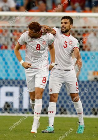 Tunisia's Oussama Haddadi, right, congratulates teammate Fakhreddine Ben Youssef on scoring their side's opening goal during the group G match between Panama and Tunisia at the 2018 soccer World Cup in the Mordovia Arena in Saransk, Russia