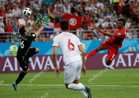 Tunisia goalkeeper Aymen Mathlouthi stops a shot by Panama's Edgar Barcenas, right, during the group G match between Panama and Tunisia at the 2018 soccer World Cup in the Mordovia Arena in Saransk, Russia