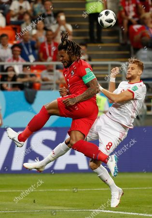Panama's Roman Torres, left, and Tunisia's Fakhreddine Ben Youssef compete for a ball during the group G match between Panama and Tunisia at the 2018 soccer World Cup in the Mordovia Arena in Saransk, Russia