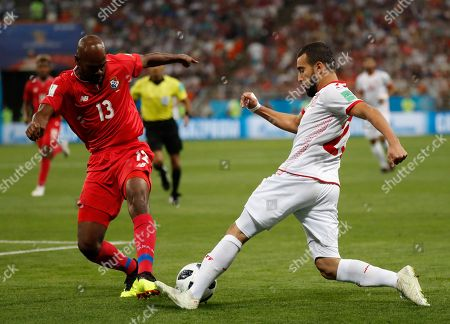 Panama's Adolfo Machado, left, and Tunisia's Naim Sliti compete for a ball during the group G match between Panama and Tunisia at the 2018 soccer World Cup in the Mordovia Arena in Saransk, Russia