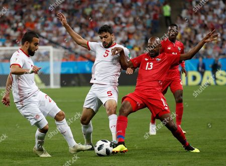 Panama's Adolfo Machado, right, challenges Tunisia's Oussama Haddadi, center, and Naim Sliti during the group G match between Panama and Tunisia at the 2018 soccer World Cup in the Mordovia Arena in Saransk, Russia