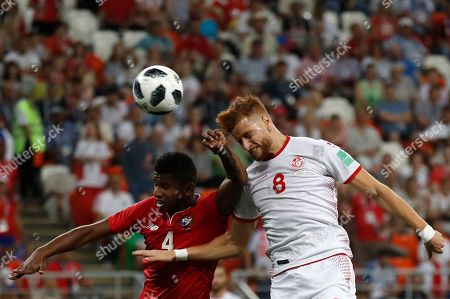 Panama's Fidel Escobar, left, and Tunisia's Fakhreddine Ben Youssef, jump for a header during the group G match between Panama and Tunisia at the 2018 soccer World Cup in the Mordovia Arena in Saransk, Russia