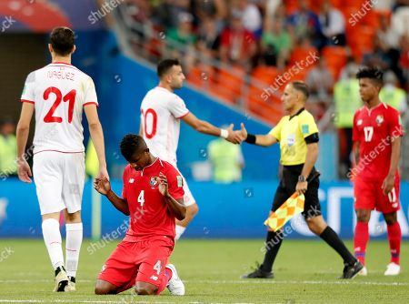 Fidel Escobar (down) of Panama reacts after the FIFA World Cup 2018 group G preliminary round soccer match between Panama and Tunisia in Saransk, Russia, 28 June 2018. (RESTRICTIONS APPLY: Editorial Use Only, not used in association with any commercial entity - Images must not be used in any form of alert service or push service of any kind including via mobile alert services, downloads to mobile devices or MMS messaging - Images must appear as still images and must not emulate match action video footage - No alteration is made to, and no text or image is superimposed over, any published image which: (a) intentionally obscures or removes a sponsor identification image; or (b) adds or overlays the commercial identification of any third party which is not officially associated with the FIFA World Cup)
