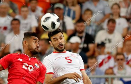 Anibal Godoy (L) of Panama and Oussama Haddadi of Tunisia in action during the FIFA World Cup 2018 group G preliminary round soccer match between Panama and Tunisia in Saransk, Russia, 28 June 2018. (RESTRICTIONS APPLY: Editorial Use Only, not used in association with any commercial entity - Images must not be used in any form of alert service or push service of any kind including via mobile alert services, downloads to mobile devices or MMS messaging - Images must appear as still images and must not emulate match action video footage - No alteration is made to, and no text or image is superimposed over, any published image which: (a) intentionally obscures or removes a sponsor identification image; or (b) adds or overlays the commercial identification of any third party which is not officially associated with the FIFA World Cup)