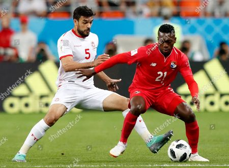 Stock Photo of Oussama Haddadi (L) of Tunisia and Jose Luis Rodriguez of Panama in action during the FIFA World Cup 2018 group G preliminary round soccer match between Panama and Tunisia in Saransk, Russia, 28 June 2018. (RESTRICTIONS APPLY: Editorial Use Only, not used in association with any commercial entity - Images must not be used in any form of alert service or push service of any kind including via mobile alert services, downloads to mobile devices or MMS messaging - Images must appear as still images and must not emulate match action video footage - No alteration is made to, and no text or image is superimposed over, any published image which: (a) intentionally obscures or removes a sponsor identification image; or (b) adds or overlays the commercial identification of any third party which is not officially associated with the FIFA World Cup)