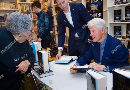 "President Bill Clinton sign copies of ""The President is Missing"" at Book Revue, in Huntington, NY"