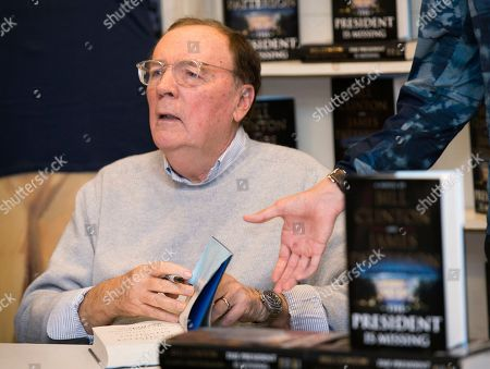 "James Patterson signs copies of ""The President is Missing"" at Book Revue, in Huntington, NY"