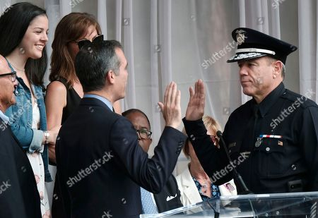 Eric Garcetti, Michel Moore. Los Angeles Mayor Eric Garcetti, left, swears in longtime Police Department veteran Michel Moore as Los Angeles's new police chief at the police academy on . Moore replaces Charlie Beck, who retired Wednesday, June 27, after more than 40 years with the LAPD