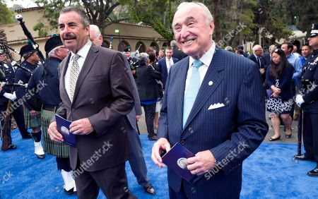 Stock Photo of Charlie Beck, Bill Bratton. Former Los Angeles police chief Bill Bratton, right, arrives with retiring chief Charlie Beck prior to a swearing in ceremony for Michel Moore at the police academy on . Moore replaces Charlie Beck, who retired Wednesday, June 27, 2018, after more than 40 years with the LAPD
