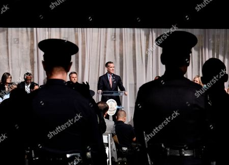 Eric Garcetti, Michel Moore. Los Angeles Mayor Eric Garcetti, center, talks prior to swearing in longtime Police Department veteran Michel Moore as the new Los Angeles Police Chief at the police academy on . Moore replaces Charlie Beck, who retired Wednesday, June 27, 2018, after more than 40 years with the LAPD. Beck became the chief in 2009