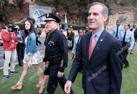 Michel Moore. Los Angeles Mayor Eric Garcetti, right arrives with Michel Moore his wife Cindy and daughter Haley before being sworn in as the new Los Angeles Chief at the police academy on. Moore replaces Charlie Beck, who retired Wednesday, June 27, 2018, after more than 40 years with the LAPD. Beck became the chief in 2009