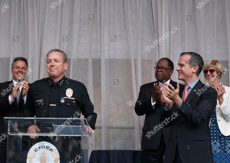 Eric Garcetti, Michel Moore. Los Angeles Mayor Eric Garcetti, second from right, flanked by Rep. Janice Hahn, D-Calif. right, and Chairman of the Los Angeles County Board of Supervisors Mark Ridley-Thomas, third from right, as they congratulate longtime police department veteran Michel Moore, second from left, after he was sworn in as the new Los Angeles new police chief. Moore replaces Charlie Beck, who retired Wednesday, June 27, 2018, after more than 40 years with the LAPD. Beck became the chief in 2009
