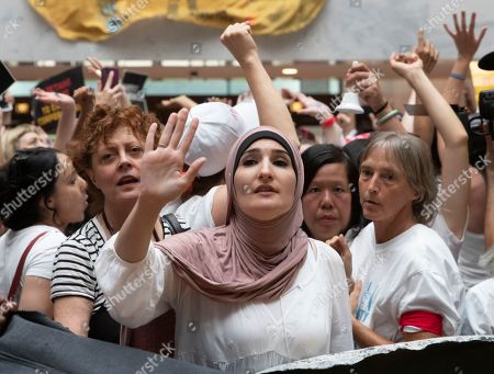 Susan Sarandon, Linda Sarsour. Hundreds of activists, including actress Susan Sarandon, center left, challenge the Trump administration's approach to illegal border crossings and separation of children from immigrant parents, in the Hart Senate Office Building on Capitol Hill in Washington