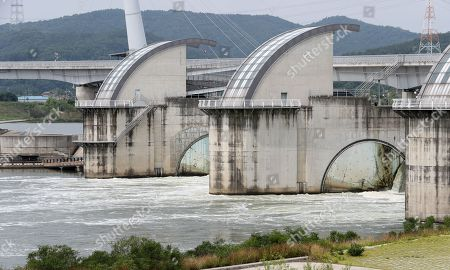 The Nakdong River flows through the floodgates of the Gangjeong-Goryeong Dam in Daegu, South Korea, 29 June 2018. Earlier in the day, the government announced the outcome of the opening of dams in the Nakdong and three other major rivers over the past year. The dams were set up under the Lee Myung-bak government's 'Four Major Rivers Project,' which critics say worsened water quality and spread harmful green tides.
