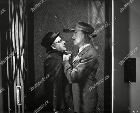 Eddie Byrne, as Supt. Harcourt, and Arthur Lowe, as Sam