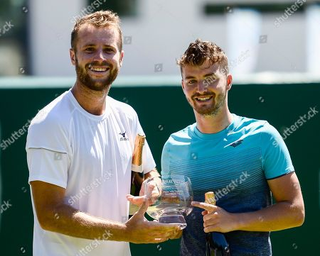 Luke Bambridge and Jonny O'Mara celebrate with the trophy after their victory in the men's double final against Ken and Neal Skupski