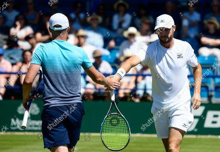 Luke Bambridge and Jonny O'Mara celebrate with a high five