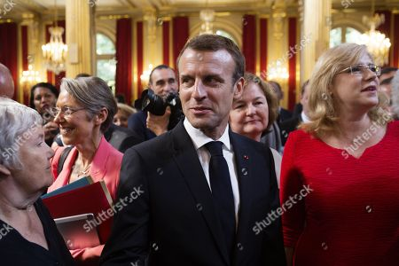 French President Emmanuel Macron (C) poses with European Commissioner for Regional Policy Corina Cretu (R) after the meeting