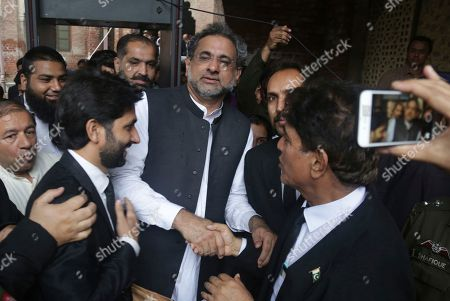 Shahid Khaqan Abbasi, Nawaz Sharif. Pakistani former Prime Minister Shahid Khaqan Abbasi, center, leaves a court in Lahore, Pakistan, . The court disqualified Abbasi, a prominent leader in the Pakistan Muslim League, from running in the July elections for concealing assets