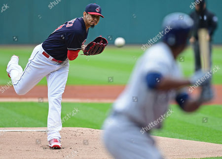 Stock Photo of Cleveland Indians starting pitcher Carlos Carrasco delivers to Milwaukee Brewers' Jonathan Cain in the first inning of a baseball game, in Cleveland. The Indians won 3-1