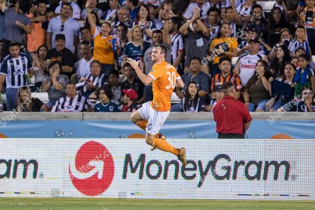 Stock Photo of Houston Dynamo defender Conor Donovan (30) celebrates his goal during a friendly match between the Houston Dynamo and the Monterrey Rayados for the BBVA Compass Dynamo Charities Cup at BBVA Compass Stadium in Houston, TX. Monterrey won the game 2 to 1