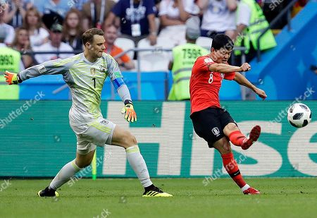 Germany goalkeeper Manuel Neuer, left, and South Korea's Ju Se-jong during the group F match between South Korea and Germany, at the 2018 soccer World Cup in the Kazan Arena in Kazan, Russia