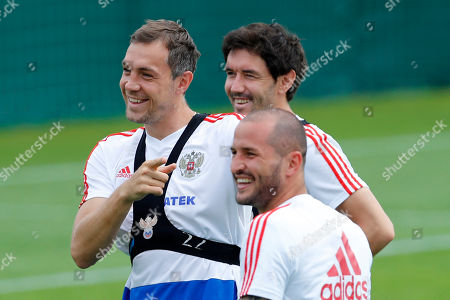 Russia's Artyom Dzyuba, left, Russia's Fyodor Kudryashov center, and Russia's Yuri Zhirkov laugh during Russia's official training ahead of the round of 16 match between Russia and Spain at the 2018 soccer World Cup at the Federal Sports Centre Novogorsk, near Moscow, Russia