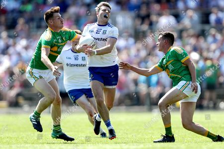 Leitrim vs Monaghan. Monaghan's Dessie Ward tackled by Shane Quinn and James Mitchell of Leitrim