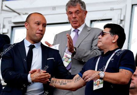 Argentinian soccer legend Diego Maradona (R) and former French player Mikael Silvestre during the FIFA World Cup 2018 round of 16 soccer match between France and Argentina in Kazan, Russia, 30 June 2018. (RESTRICTIONS APPLY: Editorial Use Only, not used in association with any commercial entity - Images must not be used in any form of alert service or push service of any kind including via mobile alert services, downloads to mobile devices or MMS messaging - Images must appear as still images and must not emulate match action video footage - No alteration is made to, and no text or image is superimposed over, any published image which: (a) intentionally obscures or removes a sponsor identification image; or (b) adds or overlays the commercial identification of any third party which is not officially associated with the FIFA World Cup)